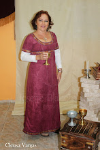 Photo: Vestido Medieval com decote império em camurça e algodão com gorgorão enfeitando, manga, decote e barra.( cada modelo de figurino é único e exclusivo). A partir de R$ 150,00.