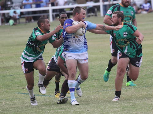 Blues skipper Sean Russ charges forward as Panthers Trey Doolan, Luke Combo and Matthew O'Connor try to take him down. Behind is Justin Croaker.