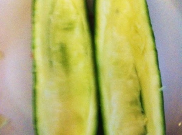 heat oven to 450 degree's.  Cut 2 Zucchini's in half length wise. Run a...