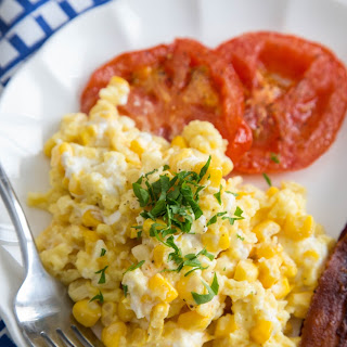 Scrambled Eggs with Fresh Corn, Goat Cheese & Tomatoes.