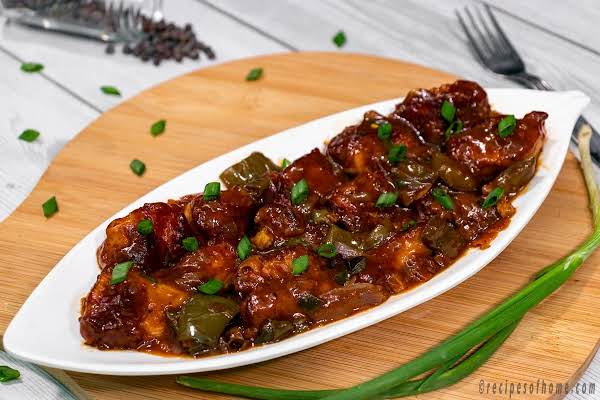 Spicy Chili Chicken Served Hot On A White Plate