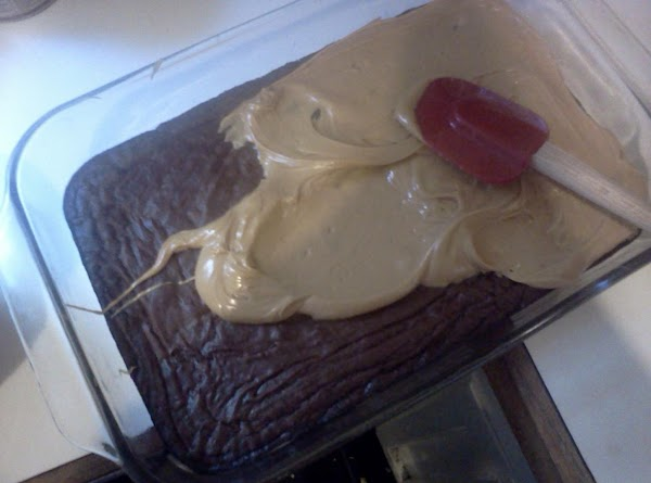 When brownies are cool spread peanut butter mixture over the top.