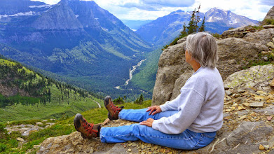 Photo: Rest time overlooking McDonald Creek - You can see a tiny portion of the Going to the Sun Road just to the left of Mardi's right foot.