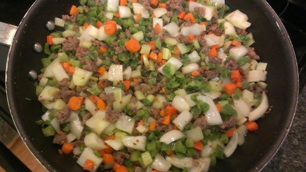 After sausage is browned, add vegetables: Carrot, celery, onion and frozen diced green bell...