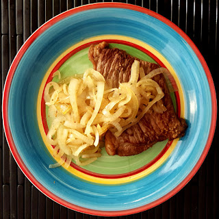 Bistec Encebollado – Steak and Onions.