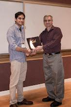 Photo: Siddhartho Bhattacharya accepting the Warren Y. Dere Design Award.