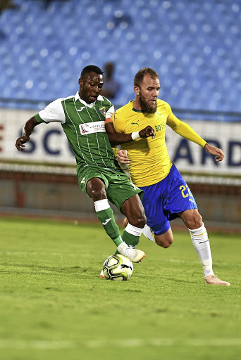 Jeremy Brockie, in yellow, and his Mamelodi Sundowns teammates are looking to qualify for the group stage of the CAF Champions League should they beat Ahli Benghazi of Libya. /Lefty Shivambu/Gallo Images