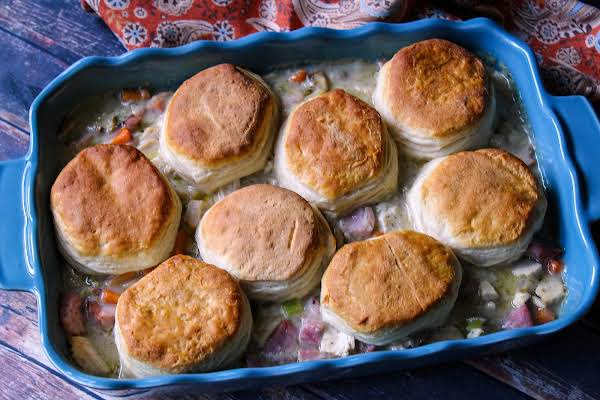 Ham & Turkey Bake With Browned Biscuits On Top.