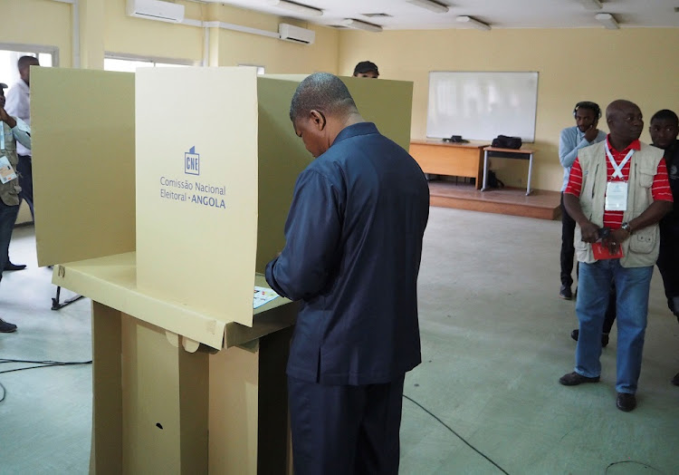 Joao Lourenco, presidential candidate for the ruling MPLA party, votes in Luanda, Angola, on Wednesday. Picture: REUTERS