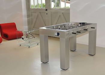 Kicker foosball table in entertainment area