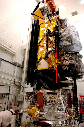 Inside the payload processing facility at Vandenberg Air Force Base has been rotated to a vertical position.