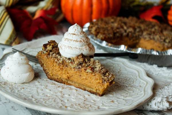 A Slice Of Pumpkin Pie With Whipped Topping.