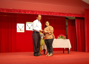 Photo: Tripti Arora receiving the Excellence Award. She did well in O Level.