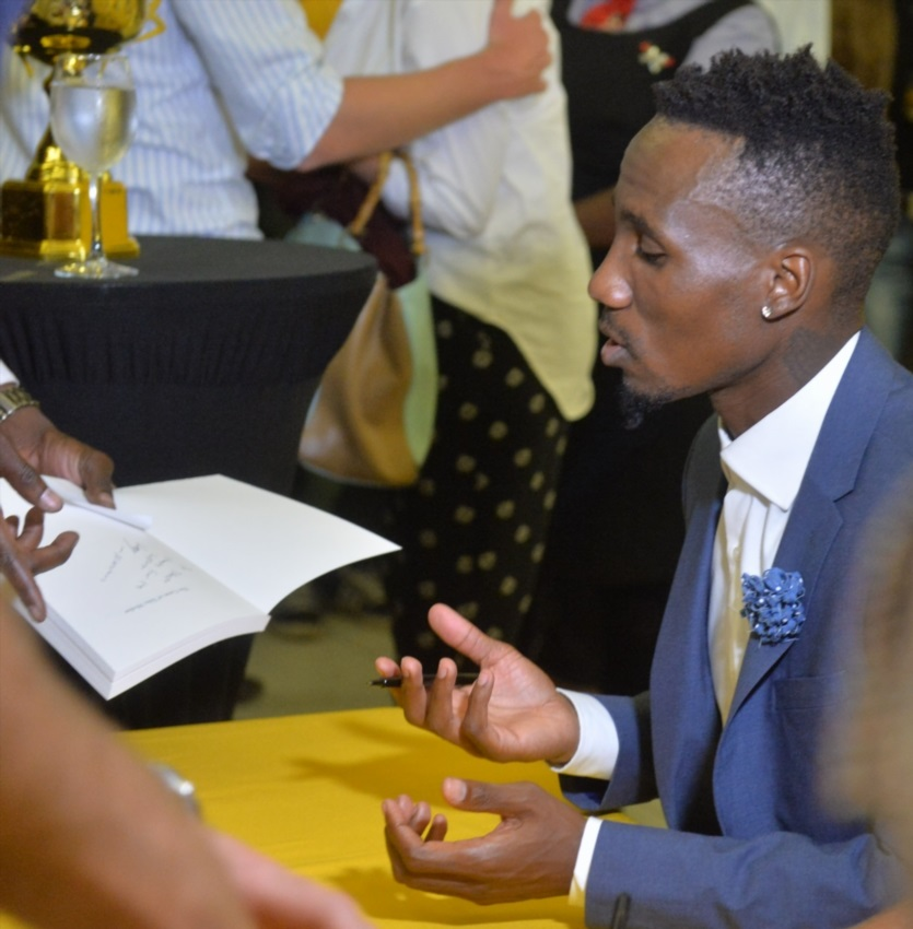 Teko Modise sign his book during the Launch of the book, The Curse of Teko Modise at Exclusive Books, Mall of Rosebank on November 29, 2017 in Johannesburg.