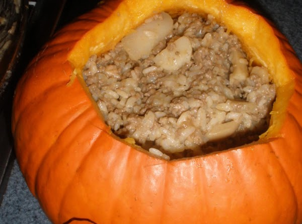 spoon into the clean pumpkin shell. place pumpkin onto a cookie pan that has...