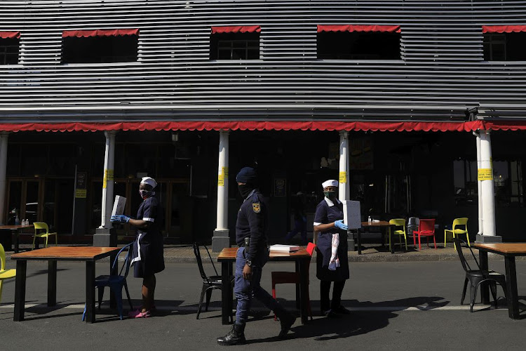 Restaurant workers protest in Norwood, Johannesburg, on July 22 2020. The restaurant industry called for one million seats placed on the streets around South Africa to protest lockdown regulations.