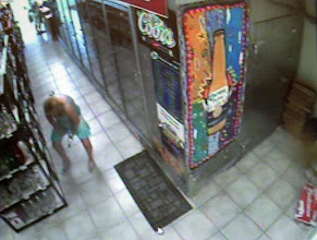Photo: Security Photo from Arkansas, the girl is stealing a bottle of vodka... you figure it out from there.