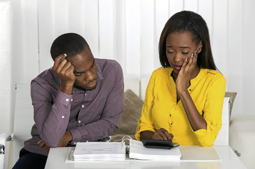 As a couple, you can't put your own financial health and monthly budget at risk by spending money you can't afford on family demands. / 123RF