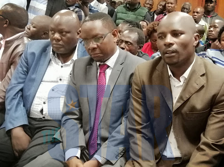 Former Kisumu County Assembly Speaker Onyango Oloo (middle) accompanied by Roy Samu and Caleb Omoro at the Employment and Labour Relations Court on Tuesday, December 10, 2019.