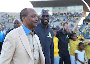 Mamelodi Sundowns billionaire owner-president Patrice Motsepe celebrates with fans after his team won the league championship.
