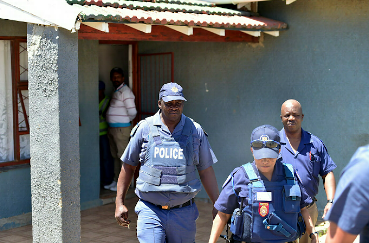 Police leave the Booysen Park home where the shooting occurred
