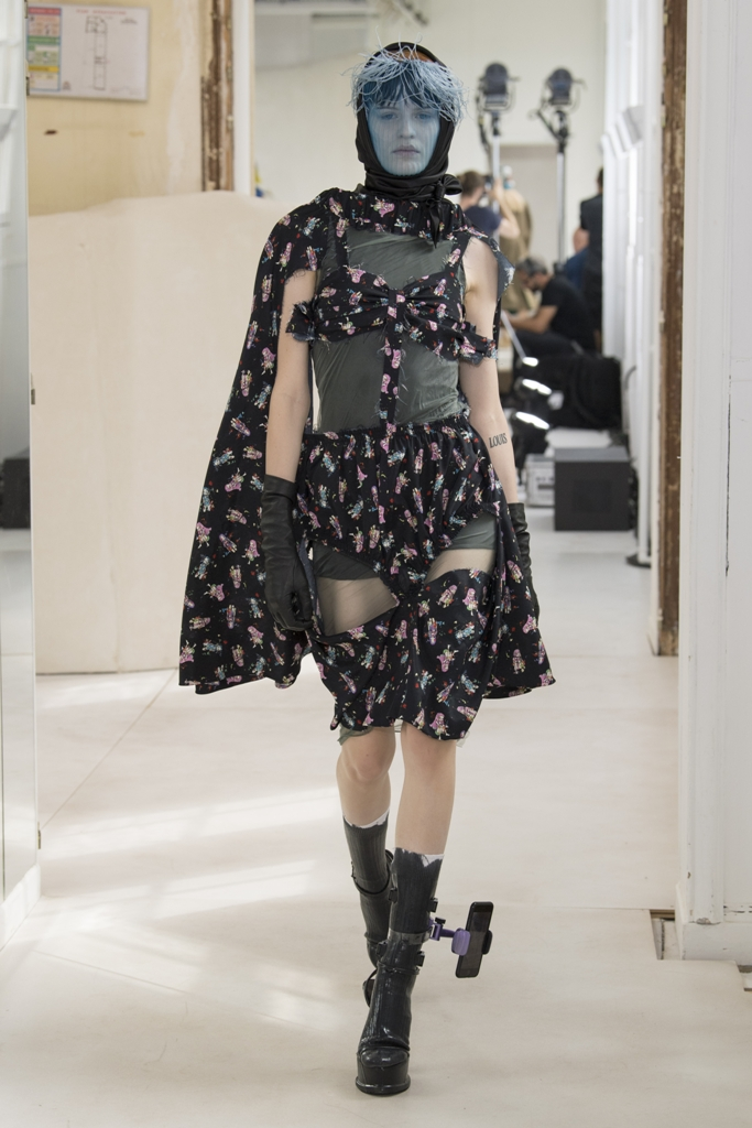 At Maison Margiela Artisanal, towering platform footwear was worn with handy mobile phone holders. The show also featured several 3D-printed accessories.