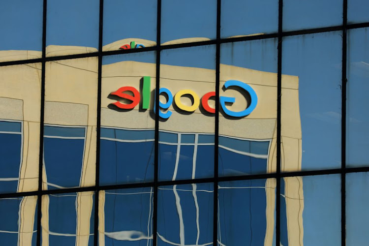 The Google logo is shown reflected on an adjacent office building in Irvine, California.