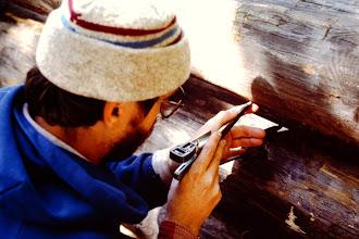 Photo: Dan scribing a log.