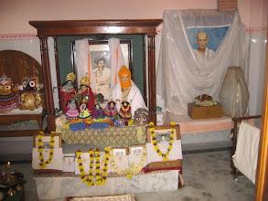 Photo: The shrine and altar of Prabhu Jagadbandhu at the center, Jagannath, Balaram and Subhadra on the left and Sri Bandhubilas Brahmachari on the right of screen