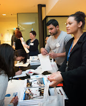 Photo: Felise Ramice, a PhD student, Ashleigh Clarke and Mark Wright helping out with registration