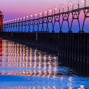 South Haven Lighthouse after Sundown by Kenneth Keifer - Buildings & Architecture Public & Historical ( navigational aid, breakwater, lighthouse, dusk, south haven lighthouse, sea, red, navigation, pier, causeway, midwest, lights, south haven, south pierhead light, tower, lake michigan, sky, waves, reflection, michigan, great lakes, south haven light, people, cat walk, shine, nautical, beacon, light, catwalk, shining, silhouette, purple, silhouetted, maritime, evening )