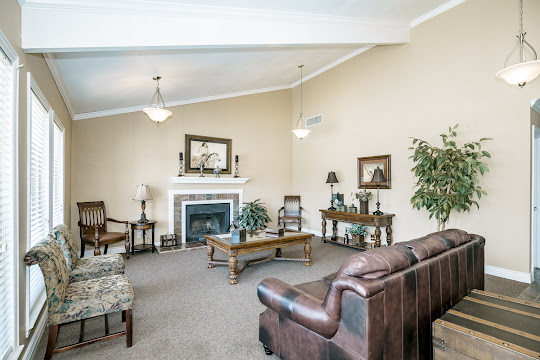 Community clubhouse with lounge furniture and fireplace