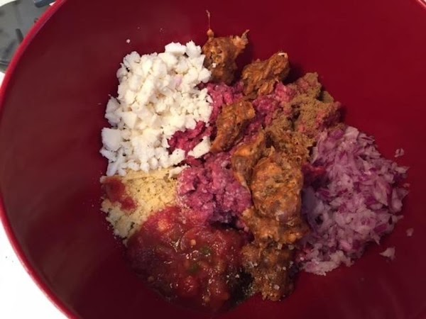 Into a bowl, crumble both meats with the salt, pepper and cumin. Add the...