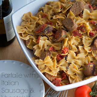 Farfalle with Italian Sausage & Vegetables in a White Wine Goat Cheese Sauce.