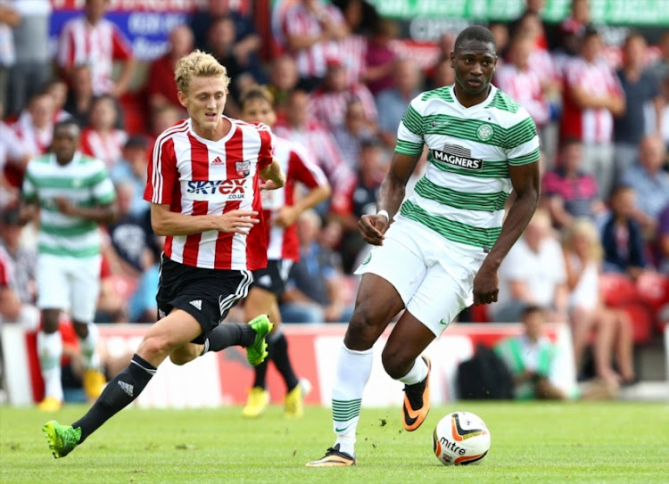 Amido Balde of Celtic battles with George Saville of Brentford during a pre season friendly match between Brentford and Celtic at Griffin Park on July 20, 2013 in Brentford, England.