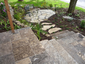 Photo: Consider having paths and seating areas through and in the garden. Gardens are meant to be enjoyed, not just views from the outside.