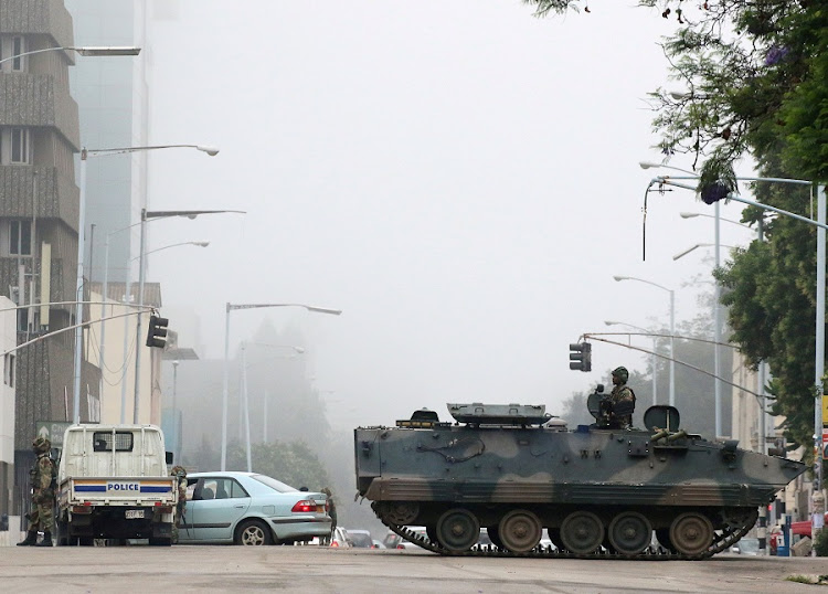Military vehicles and soldiers patrol the streets in Harare, Zimbabwe. Picture: REUTERS/PHILIMON BULAWAYO