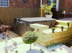 Photo: The ez pad installation was simple and quick and fit right in with my design. It allowed me to mount my hot tub on grade so I could match the height of an existing deck and also add additional features around it. Tom R, Greensboro NC