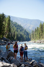 Photo: River guides scouting rapid while whitewater rafting on the Main Salmon River in central Idaho.