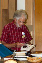 Photo: Jeff Annis views an interesting book in the library.
