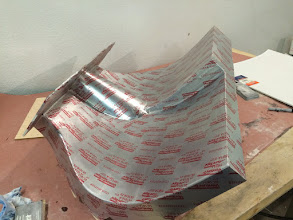 Photo: Taped the mold with aluminum flashing tape and waxed it for release.  The red printing transferred to the part though.