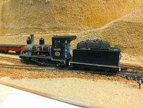 Photo: 116 Ted Polet brought a selection of his well known Craigcorrie & Dunalistair Railway stock over from the Netherlands for NG South and found Khan to be a very suitable setting to give his own scratchbuilt 4-4-0 Lawley loco, built for the Beira Railway a run in the African sunshine on Julian Evison's Khan! Newcomers to fall under the spell of Ted Polet's modelling sagas may not know that it is now 21 years since he described in 009 News how he built this superb locomotive .