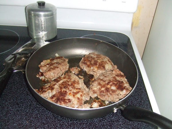 "In a large cast iron skillet.14"".Add olive oil,On med heat. Add patties and brown..."