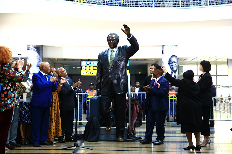 President Jacob Zuma, with the Tambo family and officials, unveiled a life size statue of OR Tambo at the international arrival section of the OR Tambo Airport in Kempton Park.