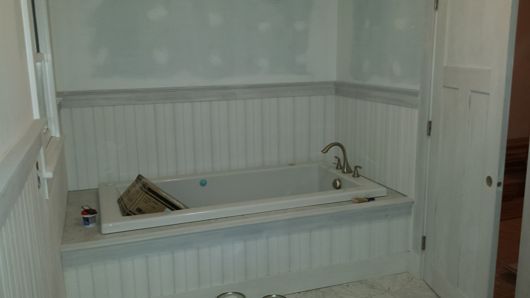 A view of the tub trim finished too! Most of that is removable in case we ever need to get under the tub to the pump.
