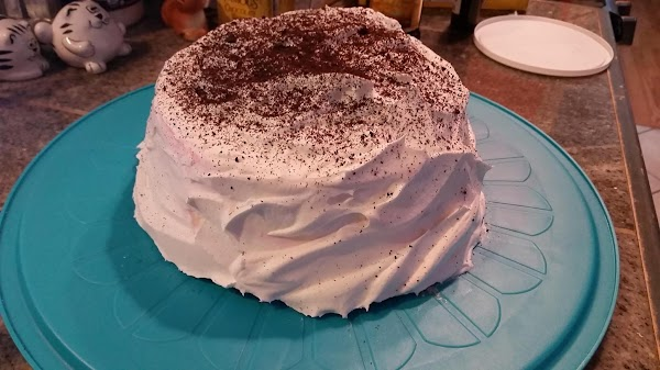 """""""Frost"""" the cake with the second container of whipped topping."""