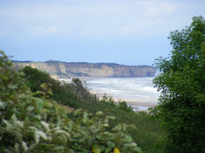 Photo: The view down to Pointe du Hoc, our next stop.