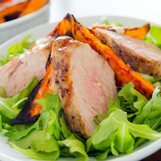 Slow Cooker Pork and Sweet Potatoes over Kale Salad.