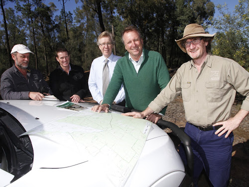 AWC ecologist John Kanowski, National Parks and Wildlife Service regional manager Rob Smith, Narrabri Shire economic development manager Bill Birch, State Member for Barwon Kevin Humphries and AWC chief executive Atticus Fleming in Pilliga State Forest for yesterday's announcement.
