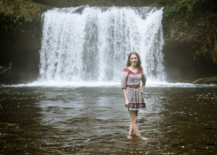Photo: This was her idea. Maybe she just didn't realize how cold the water would be in November. I was more than happy to oblige my daughters request for some photos at a waterfall. I chose Butte Creek Falls as I knew the hike was easy, the water is shallow, and there would be very few to no people here. Because of the cold and the rain it was a quick shoot but a fun one nonetheless. I'm sure there will be more in the future, she's a fun kid to hangout with.  The spray coming off the falls and the rain coming down made it impossible to keep the lens dry so I there was a natural haze to the image. I took that and ran with it to give this image a 70's film feel to match with the cute dress Brianna was wearing.  #buttecreekfalls  #oregon  #photography